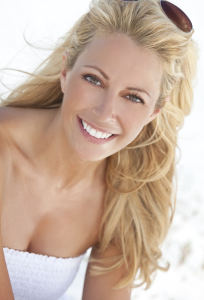 blonde woman smiling on the beach