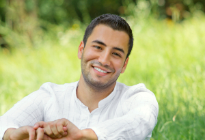 Man sitting in the grass smiling