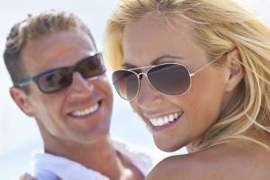Smiling couple outside wearing sunglasses